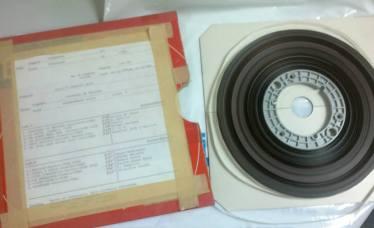 Carrete de cinta donde fue grabado originalmente el tema musical
